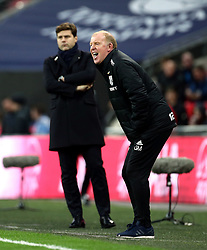 Tottenham Hotspur manager Mauricio Pochettino and West Bromwich Albion caretaker manager Gary Megson (right) during the Premier League match at Wembley Stadium, London.