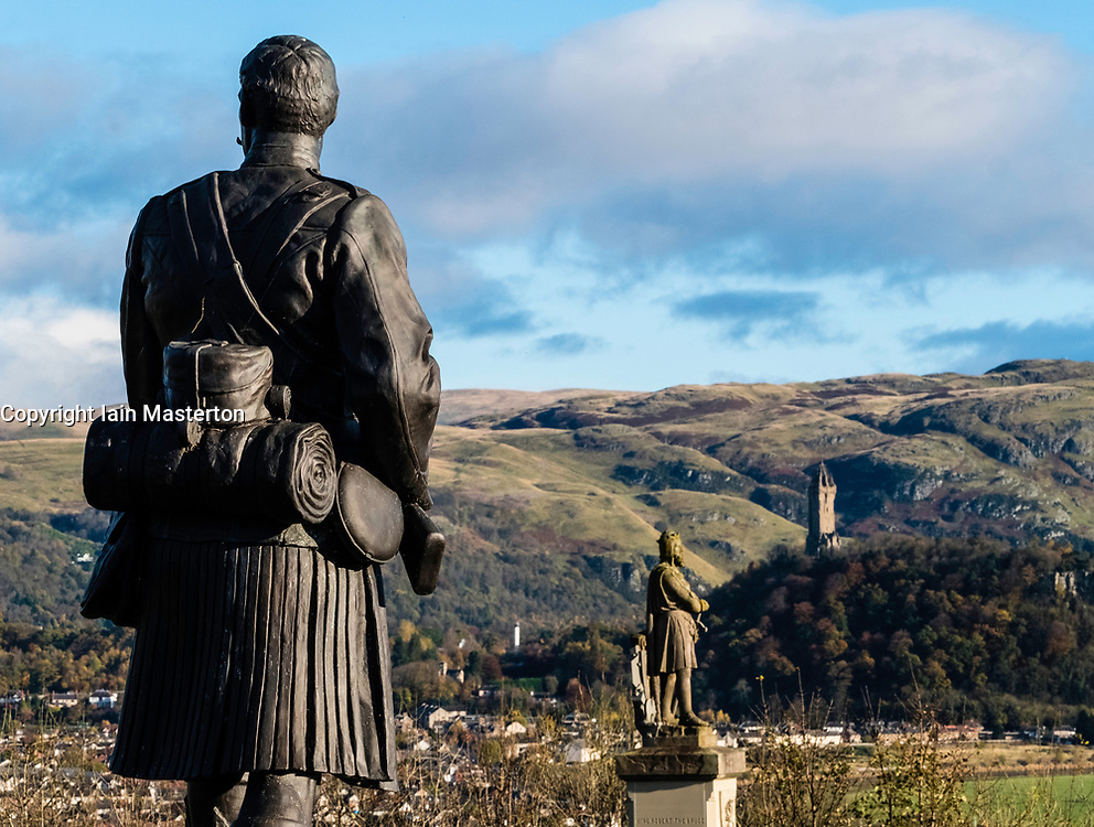 South African War Memorial statue and Statue of Robert the Bruce at Stirling Castle and Wallace Monument in distance  , Stirlingshire, Scotland, United Kingdom.