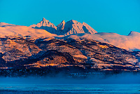 Winter landscape along the coastline near Tromso, Arctic, Northern Norway at sunrise.