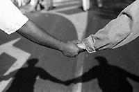 1995, Paris, France --- Black and White Demonstrators Hold Hands --- Image by © Owen Franken/CORBIS