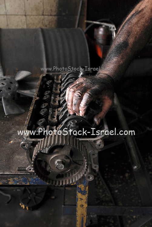 mechanic fixing a motor in a workshop