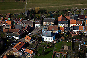 Nederland, Limburg, Gemeente Stein, 07-03-2010; Urmond, dorpje aan de Maas, met historisch kerkje.Small village on the banks of the river  Meuse, with historic church.luchtfoto (toeslag), aerial photo (additional fee required).foto/photo Siebe Swart
