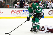 DALLAS, TX - SEPTEMBER 26:  Tyler Seguin #91 of the Dallas Stars controls the puck against the Colorado Avalanche in an NHL preseason game on September 26, 2013 at the American Airlines Center in Dallas, Texas.  (Photo by Cooper Neill/Getty Images) *** Local Caption *** Tyler Seguin