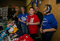 Sue and Peter Kearney with their son PJ and friend Aidan Camblor work the raffle table during the Pro Wrestling Injustice for Brawl event at the Whiskey Barrel Saturday night.  Proceeds from the event to benefit PJ and the Boston Children's Hospital.  (Karen Bobotas/for the Laconia Daily Sun)