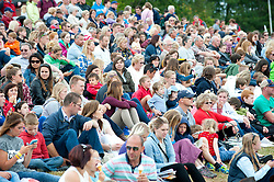 © Licensed to London News Pictures. 21/07/2015. Llanelwedd, UK. Visitors watch the events in the Main Ring. The Royal Welsh Show is hailed as the largest & most prestigious event of it's kind in Europe. In excess of 200,000 visitors are expected this week over the four day show period - 2014 saw 237,694 visitors, 1,033 tradestands & a record 7,959 livestock exhibitors. The first ever show was at Aberystwyth in 1904 and attracted 442 livestock entries. Photo credit: Graham M. Lawrence/LNP