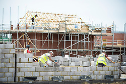"Embargoed to 0001 Friday May 5 File photo dated 25/08/16 of builders on a building site. Reforms to quicken the ""drip-fed"" housebuilding process are needed, according to a think tank."
