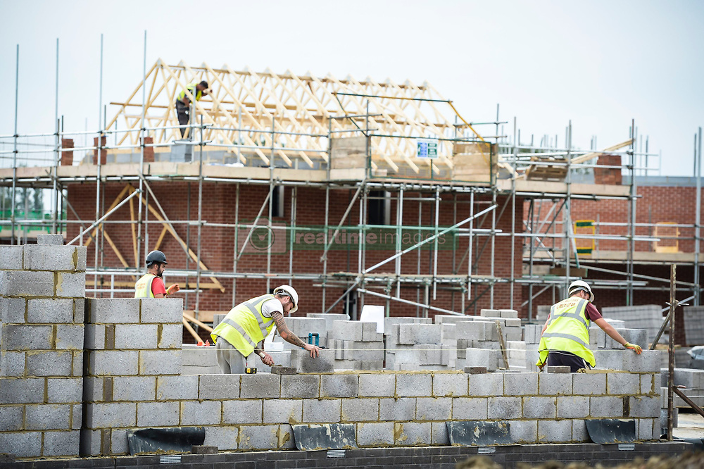 """Embargoed to 0001 Friday May 5 File photo dated 25/08/16 of builders on a building site. Reforms to quicken the """"drip-fed"""" housebuilding process are needed, according to a think tank."""