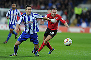 Cardiff city's Craig Bellamy is held back by Lewis Buxton. NPower championship, Cardiff city v Sheffield Wednesday at the Cardiff city Stadium in Cardiff on Sunday 2nd Dec 2012. pic by Andrew Orchard, Andrew Orchard sports photography,