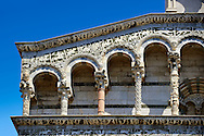 Close up of the Arcades and corner of St Michele of the 13th century Romanesque facade of the San Michele in Foro,  a Roman Catholic basilica church in Lucca, Tunscany, Italy .<br /> <br /> Visit our ITALY PHOTO COLLECTION for more   photos of Italy to download or buy as prints https://funkystock.photoshelter.com/gallery-collection/2b-Pictures-Images-of-Italy-Photos-of-Italian-Historic-Landmark-Sites/C0000qxA2zGFjd_k<br /> <br /> If you prefer to buy from our ALAMY PHOTO LIBRARY  Collection visit : https://www.alamy.com/portfolio/paul-williams-funkystock/lucca.html .<br /> <br /> Visit our MEDIEVAL PHOTO COLLECTIONS for more   photos  to download or buy as prints https://funkystock.photoshelter.com/gallery-collection/Medieval-Middle-Ages-Historic-Places-Arcaeological-Sites-Pictures-Images-of/C0000B5ZA54_WD0s