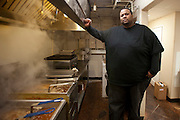 """Darrel """"Big Coop"""" Cooper owner of DC Fried Ribs on Gentry stands by the friers working overtime making spicy and regular fried ribs both hot sellers.© 2011 Jaime R. Carrero/Tyler Morning Telegraph"""