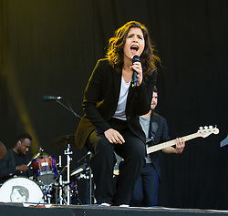© Licensed to London News Pictures. 13/06/2015. Newport, UK.   Jessie Ware performing live at Isle of Wight Festival 2015, Day 3 Saturday.  This afternoon as started with warm sunshine.  Yesterday the rain was torrential.  Headline acts include The Prodigy, Blur and Fleetwood Mac.   Photo credit : Richard Isaac/LNP