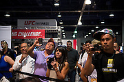 LAS VEGAS, NV - JULY 10:  Fans watch the IMMAF Championships during the UFC Fan Expo at the Las Vegas Convention Center on July 10, 2016 in Las Vegas, Nevada. (Photo by Cooper Neill/Zuffa LLC/Zuffa LLC via Getty Images) *** Local Caption ***
