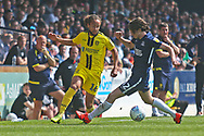 Burton Albion midfielder Marcus Harness (16) and Southend United 's Sam Hart (42) during the EFL Sky Bet League 1 match between Southend United and Burton Albion at Roots Hall, Southend, England on 22 April 2019.
