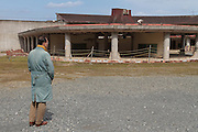 People visit the ruins of Okawa Elementary school in Ishinomaki, Miyagi, Japan. Thursday March 10th 2016. The Great East Japan Earthquake struck at 2:46pm on March 11th 2011 levelling much of the Tohoku coast and causing the deaths of around 18,000 people. including 84 students and staff at Okawa Elementary School.