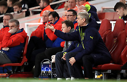 Arsenal manager Arsene Wenger (centre) gestures from the dugout