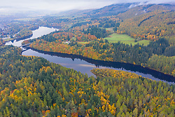 Aerial view of autumn colours of woodland at Loch at River Tummel and Loch Faskally in near Pitlochry in Perthshire, Scotland, UK