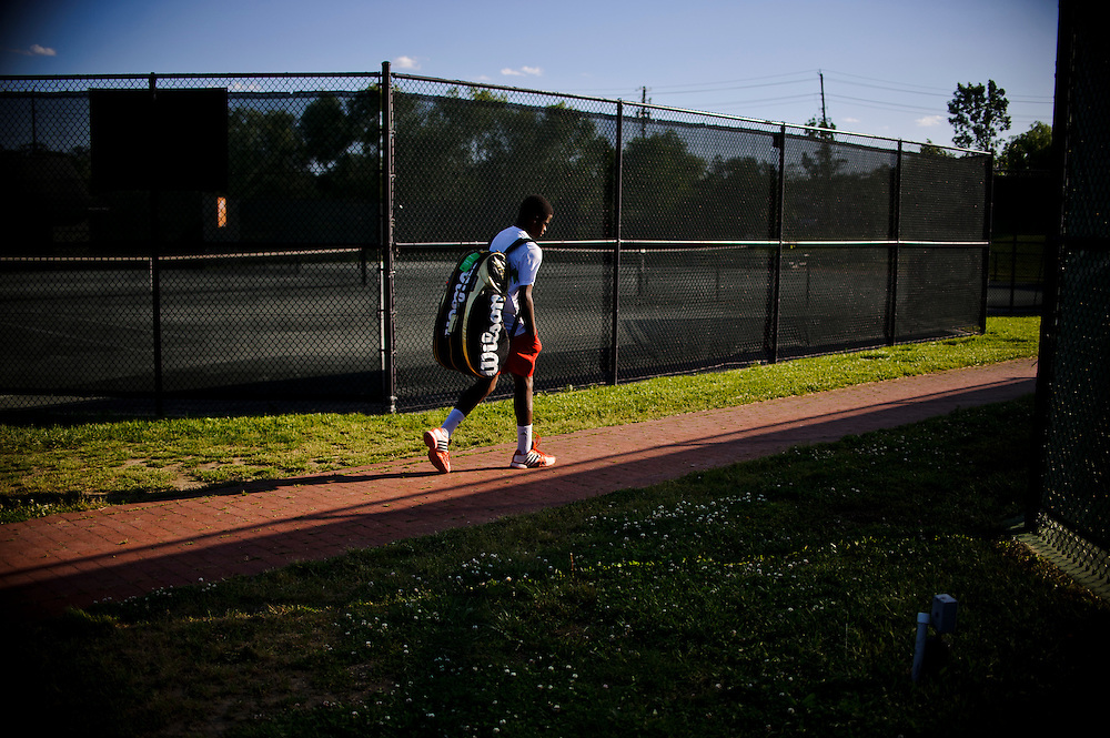 photo by Matt Roth.Friday, May 11, 2012.Assignment ID: 30125820A..Francis Tiafoe, the top-ranked 14-year-old tennis player in the country, walks towards the Tennis Center at College Park's club house, Friday, May 11, 2012...His father immigrated from Sierra Leone in 1996. Francis's father, Constant lived where he worked at the Tennis Center at College Park, where Francis and his twin brother Franklin would occasionally sleep. Misha Kouznetsov, a tennis pro at the Center saw potential in Francis and has been training the twins since they were eight. Constant and his family have since moved into an apartment five minutes away, and the boys train and go to school full-time at the Center.