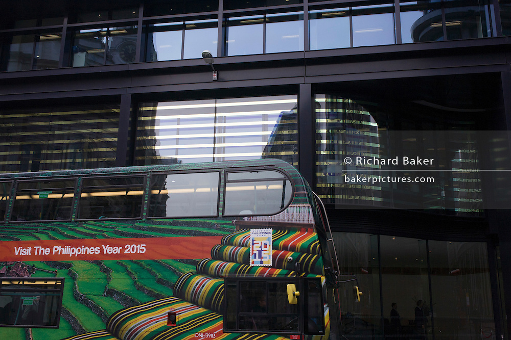 A stripes theme of a London bus promoting the Phillippines as a travel destination and reflective designs on the outside of a Threadneedle Street building in the City of London.