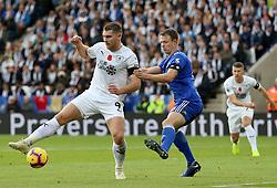 Burnley's Sam Vokes and Leicester City's Jonny Evans battle for the ball