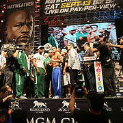 LAS VEGAS, NV - SEPTEMBER 12: WBC/WBA welterweight champion Floyd Mayweather Jr. (L) and Marcos Maidana pose during their official weigh-in at the MGM Grand Garden Arena on September 12, 2014 in Las Vegas, Nevada. Mayweather Jr. will defend his titles against Maidana on September 13 in Las Vegas. (Photo by Alex Menendez/Getty Images) *** Local Caption *** Floyd Mayweather Jr; Marcos Maidana