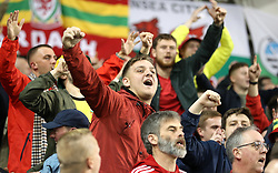 Wales fans in the stands show their support during the UEFA Nations League, League B, Group four match at The Aviva Stadium, Dublin. PRESS ASSOCIATION Photo. Picture date: Tuesday October 16, 2018. See PA story SOCCER Republic. Photo credit should read: Liam McBurney/PA Wire.