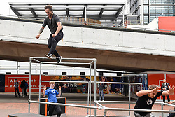© Licensed to London News Pictures. 19/08/2018. LONDON, UK.  Parkour practitioners take part in a professionally choreographed performance during the Rendezvous International Parkour Gathering XIII 2018 at Wembley Park.  The three day training event, organised by Parkour Generations, brings some of the world's best parkour and free running teachers to the UK to lead a series of workshops for parkour enthusiasts.  Photo credit: Stephen Chung/LNP