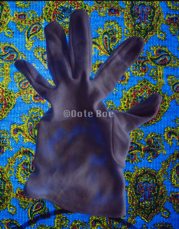 still life of a cotton glove on paisley background