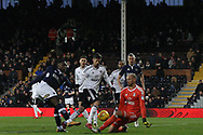 Fred Onyedinma of Millwall (L) has a shot at goal saved by David Button, the goalkeeper of Fulham (R). EFL Skybet football league championship match, Fulham v Millwall at Craven Cottage in London on Saturday 25th November 2017.<br /> pic by Steffan Bowen, Andrew Orchard sports photography.