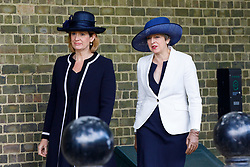 © Licensed to London News Pictures. 12/07/2017. London, UK. UK Prime Minister Theresa May and Home Secretary Amber Rudd walk to Horse Guards Parade to welcome King Felipe VI and Queen Letizia of Spain in London on the first day of State visit of the King and Queen of Spain. Photo credit: Tolga Akmen/LNP