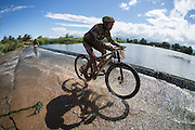 Exxaro riders cross the Breede river during stage 2 of the 2014 Absa Cape Epic Mountain Bike stage race from Arabella Wines in Robertson, South Africa on the 25 March 2014<br /> <br /> Photo by Greg Beadle/Cape Epic/SPORTZPICS