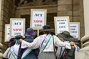 """Demonstrators illustrating the presence of women's Suffragette movement are seen attending an Extinction Rebellion fifth day of two-week protest campaign outside the Bank of England in London on Friday, Aug 27, 2021.<br /> Activists said that the wealth of this country is """"blood wealth"""" as to this day the country use its financial and armed power to exploit resources elsewhere. (VX Photo/ Vudi Xhymshiti)"""