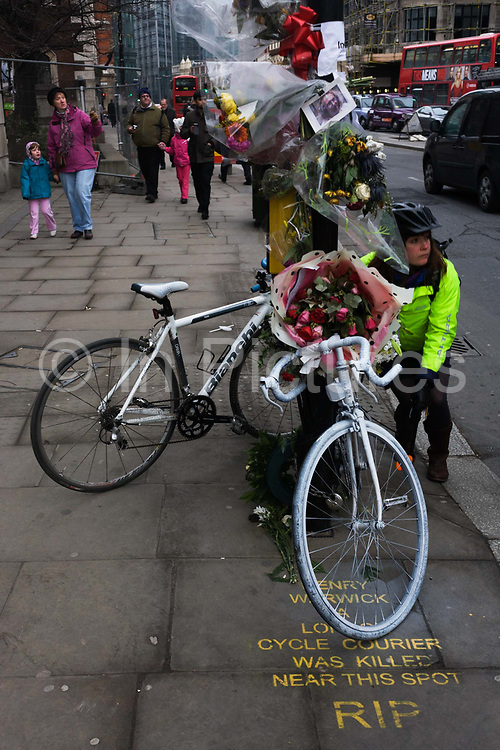 A cyclist is startled by a nearby bus horn that emits a warning to pedestrians at the location of a roadside memorial to cycle courier Henry Warwick aged 61, killed in an accident on the junction of Bishopsgate and Wormwood Street. Warwick worked for Rico Logistics and was said to be an experienced urban cyclist, working as a courier in London for more about 20 years. Nevertheless, he has joined a growing list of tragic deaths due to collisions between bikes, trucks and in this case, a Terravision coach. Over one million Londoners own bicycles and between 1986 and April 2011, 439 cyclists have been killed in traffic accidents in Greater London.