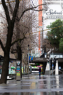A woman holding a red umbrella walks along Swanston Street in the rain during COVID-19 in Melbourne, Australia. Victoria has recorded 14 COVID related deaths including a 20 year old, marking the youngest to die from Coronavirus in Australia, and an additional 372 new cases overnight. (Photo by Dave Hewison/Speed Media)