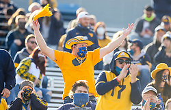 Nov 14, 2020; Morgantown, West Virginia, USA; A West Virginia Mountaineers fan cheers during the first quarter against the TCU Horned Frogs at Mountaineer Field at Milan Puskar Stadium. Mandatory Credit: Ben Queen-USA TODAY Sports