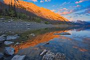 Last light on the Colin Range reflected in Medicine Lake<br />Jasper National Park<br />Alberta<br />Canada