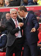 Mark Hughes, the Stoke city manager (l) shakes hands with West Ham manager Slaven Bilic before the game.Premier league match, Stoke City v West Ham Utd at the Bet365 Stadium in Stoke on Trent, Staffs on Saturday 29th April 2017.<br /> pic by Bradley Collyer, Andrew Orchard sports photography.