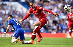 Chelsea's Eden Hazard (left) and Liverpool's Virgil van Dijk battle for the ball during the Premier League match at Stamford Bridge, London.