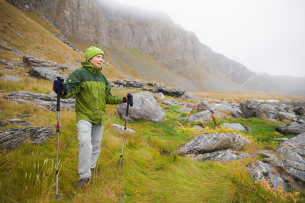 Liana Welty hikes the rocky coast of Vaeroy Island, Lofoten Islands, Norway.