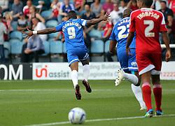 Peterborough United's Britt Assombalonga celebrates scoring the opening goal of the game - Photo mandatory by-line: Joe Dent/JMP - Tel: Mobile: 07966 386802 03/08/2013 - SPORT - FOOTBALL -  London Road Stadium - Peterborough -  Peterborough United v Swindon Town - Sky Bet One