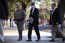 """Texas Rangers escort polygamist leader Warren Jeffs, who heads the Fundamentalist Church of Jesus Christ of Latter-Day Saints, to his sentencing hearing in San Angelo, Texas, Aug. 9, 2011. Jeffs  was sentenced to life in prison for sexually assaulting two underage girls he claimed as """"spiritual"""" brides. The Texas jury of ten women and two men deliberated for less than an hour before giving him a life sentence for one charge and 20 years for a second, the maximum sentence for both."""