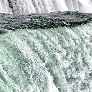 High volumes of water pass over Niagara Falls on the Niagara River on the border between the United States and Canada.
