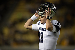 Nevada quarterback Carson Strong (12) walks off the field after his team's opening drive stalled against California during the first quarter of an NCAA college football game, Saturday, Sept. 4, 2021, in Berkeley, Calif. (AP Photo/D. Ross Cameron)