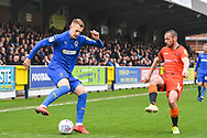 AFC Wimbledon Forward Joe Pigott (39) and Wycombe Wanderers Defender Michael Harriman (16) in action during the EFL Sky Bet League 1 match between AFC Wimbledon and Wycombe Wanderers at the Cherry Red Records Stadium, Kingston, England on 27 April 2019.