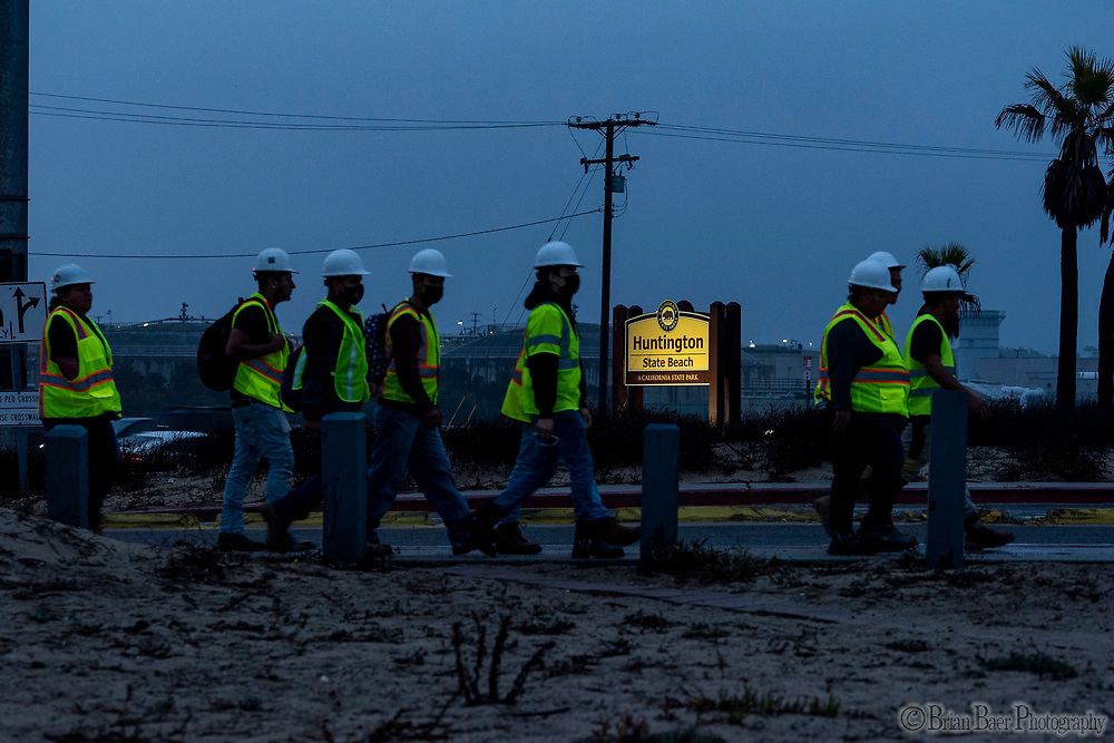 Huntington SB 10-07-2021_1699<br /> Clean up workers arrive in the AM to work<br /> Huntington State Beach<br /> © 2021, California State Parks.<br /> Photo by Brian Baer