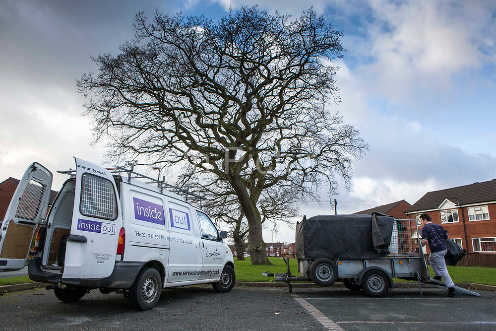 A volunteer from Longton Community Church loading up the trialer. He's working on rubbish removal from a house to improve the lives of those in need in their local community, Leyland, Lancashire.