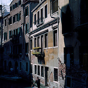 The Uniquely Romantic City of Venice was built entirely on water. The City stretches across 118 small islands in the marshy Venetian Lagoon along the Adriatic Sea in Northeast Italy. Narrow alleyways and canals pass between palaces and magnificent churches while Venice's unique Gondolas have been the source of transport along the city's canals since the eleventh century.  A Gondola makes it's way through the canal ways of Venice on May 01, 2008 in Venice, Italy. Photo Tim Clayton