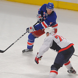 April 30, 2012: New York Rangers defenseman Michael Del Zotto (4) passes the puck away from Washington Capitals center Brooks Laich (21) during third period action in Game 2 of the NHL Eastern Conference Semifinals between the Washington Capitals and New York Rangers at Madison Square Garden in New York, N.Y.