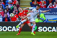 Slovakia midfielder Robert Mak tussles with Wales defender Connor Roberts during the UEFA European 2020 Qualifier match between Wales and Slovakia at the Cardiff City Stadium, Cardiff, Wales on 24 March 2019.