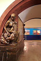 Ploshchad Revolyutsii Station, Moscow Metro  Ploshchad Revolyutsii, meaning Revolution Square, is one of the most famous stations of the Moscow Metro. It opened in 1938 and the architect was Alexey Dushkin. The station features red and yellow marble arches faced with black Armenian marble.  Each arch is flanked by a pair of bronze sculptures by M.G. Manizer depicting the people of the Soviet Union, including soldiers, farmers, athletes, writers, aviators, industrial workers, and schoolchildren. There are a total of 72 of these sculptures in the station.