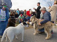 Father Alan from St Andre Bassett shares a blessing with the dogs prior to walking the Wow Trail during Saturday's Bow Wow Fest at Opechee Inn and Spa.  (Karen Bobotas/for the Laconia Daily Sun)
